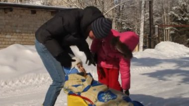 Children. sled. snow. winter. Russia. adult. child.entertainment. rest. tourism. fun. holiday. leisure. season. nature.