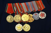 RUSSIAN FEDERATION - 2013: Medals on the parade uniform of the veteran of the Soviet Union Armed Forces. Medals commemorative, anniversary, For the Excellent Service, Veteran of the USSR Armed Forces. — Stock Photo