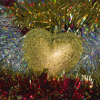 Heart of gold and tinsel — Stock Photo #15366165