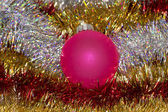 Red ball and tinsel — Stock Photo