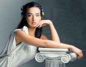 Beautiful girl in the image of an ancient goddess — Stock Photo