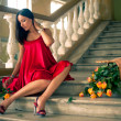 Soft focus Image of beautyful woman sitting on stairs — Stock Photo