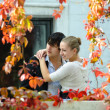 Stock Photo: Young couple embraces in garden