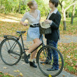 Stock Photo: Young pare and bicycle
