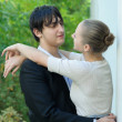 Stock Photo: Young couple embracing at column