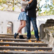 Young pair embrace the village on the stairs — Lizenzfreies Foto