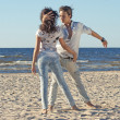 Young couple dancing on a background of sea — Stock Photo #16821337