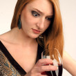 Beautiful girl frowns on alcohol — Stock Photo