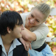 Stock Photo: Cute young couple talking in garden