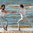 Young couple dancing on a background of sea - Stock Photo