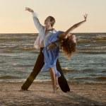 Young couple dancing tango on the beach — Stock Photo #16821617