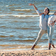 Young couple dancing on a background of sea — Stock Photo #16821621