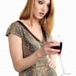 Stock Photo: Wine, emotions, the girl wonders