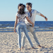 Young couple dancing on a background of sea — Stock Photo #16821713