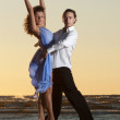 Young couple dancing tango on the beach — Stock Photo
