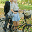 Stock Photo: Young Couple and bicycle