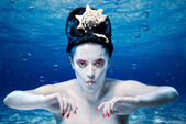 Mermaid under water with a pearl — Stock Photo