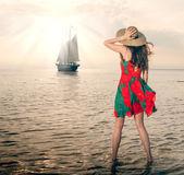 Girl in a poppy dress — Stock Photo