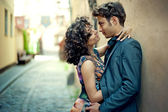Young couple kissing in the street of the old city in Spain — Stok fotoğraf