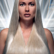 Portrait of a beautiful blonde with a long futuristic hair — Stock Photo