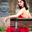 Stock Photo: Beautiful young woman in a red dress