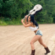Stock Photo: Sexy girl with guitar, standing on countryside road