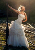 Beautiful blonde haired woman in bridal dress — Stock Photo