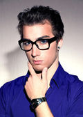Closeup portrait of handsome young adult wearing glasses - — Stock Photo