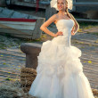 Beautiful blonde haired woman in bridal dress — Stock fotografie