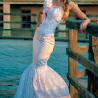 Beautiful blonde haired woman in bridal dress — Stock Photo #19212803