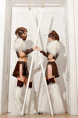 Two sexy female guards with spears crossed — Stock Photo