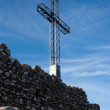 La Rocca, Italy, cross on background of sky - Stock Photo