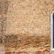 Brick texture with a window in the Gothic style — Stock Photo