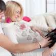 Pregnant woman with her husband at home for Christmas — Stock Photo