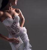 Luxe bride in form-fitting dress, catalog photo — Stock Photo