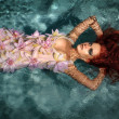 Portrait of beautiful red-haired girl in the water — Stock Photo #21007485