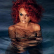 Portrait of beautiful red-haired girl in the water — Stock Photo #21007515
