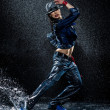 Wet dancing woman. Under waterdrops. Studio photo — Stock Photo