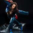 Wet dancing woman. Under waterdrops. Studio photo - Stock Photo