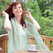 Happy woman having morning coffee outdoors — Stock Photo