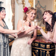 Three women partying retro style — Stock Photo #27067917