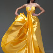 Woman in golden yellow dress — Photo
