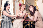 Three women partying retro style — Stock Photo