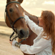 Young woman and horse — Stock Photo
