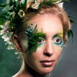 Young blond woman beauty portrait with wreath of flowers, studio shot — ストック写真