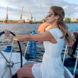 Attractive girl sailing on a yacht — Stock Photo