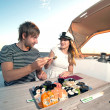 Lovely young couple eating sushi on a yacht — Stock Photo #29054135
