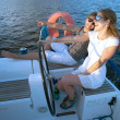 Young couple navigating on a yacht — Stock Photo