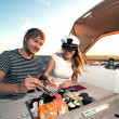Lovely young couple eating sushi on a yacht — Stock Photo #29054231