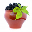 Blackberries in a clay jug — Stock Photo